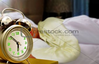 Sleeping Women and Alarm Clock