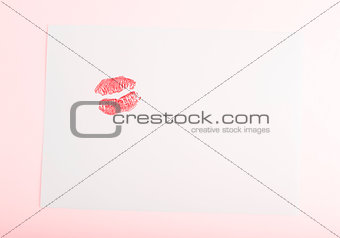 Blank card with red kiss