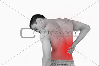 Back view of man suffering from back pain