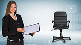 Businesswoman showing blank clipboard. Office chair beside