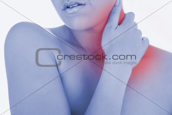Topless woman massaging neck