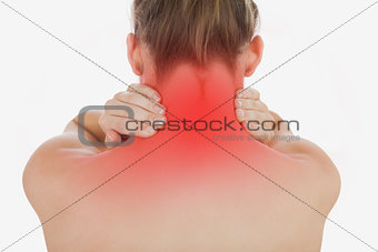 Topless woman massaging her neck