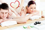 Composite image of attractive young couple enjoying a back massage