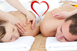 Composite image of relaxed couple receiving a back massage