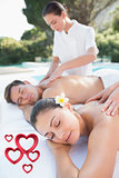 Composite image of attractive couple enjoying couples massage poolside