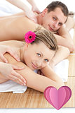 Composite image of attractive young couple receiving a back massage