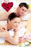 Composite image of happy couple receiving a back massage