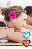 Composite image of cheerful young couple enjoying a spa treatment