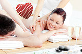 Composite image of positive young couple enjoying a back massage
