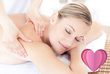 Composite image of beautiful woman receiving a back massage