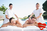 Composite image of calm couple enjoying couples massage poolside