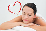 Composite image of peaceful brunette lying with salt scrub on back