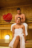 Composite image of man giving his girlfriend a neck massage in sauna