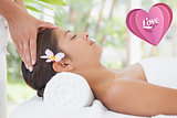 Composite image of beautiful brunette enjoying a head massage