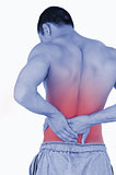 Young male suffering from back pain