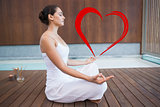 Composite image of peaceful brunette in white sitting in lotus pose