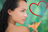 Composite image of beautiful nude brunette smelling lily
