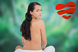 Composite image of beautiful brunette posing nude with towel at waist