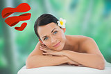 Composite image of beautiful brunette relaxing on massage table smiling at camera
