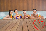 Composite image of cheerful people with drinks in swimming pool