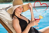 Composite image of beautiful woman holding drink by swimming pool