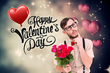 Composite image of geeky hipster offering bunch of roses