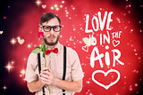 Composite image of geeky hipster offering a rose