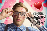 Composite image of geeky hipster covered in kisses