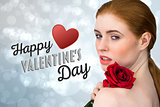 Composite image of beautiful redhead posing with red rose