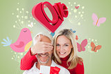 Composite image of loving couple with gift