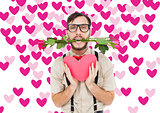 Composite image of geeky hipster offering valentines gifts