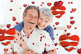 Composite image of senior couple looking at the camera
