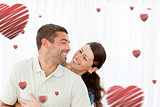Composite image of lovely couple laughing together in the living room