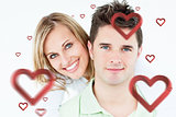 Composite image of portrait of a young happy couple standing against a white background