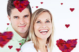 Composite image of young beautiful couple man looking at the camera