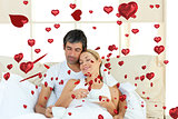 Composite image of positive couple drinking coffee lying in the bed