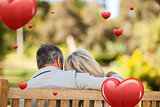 Composite image of elderly couple sitting on the bench with their back to the camera