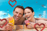 Composite image of beautiful couple drinking cocktails in the swimming pool