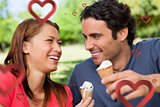Composite image of two friends laughing while holding ice cream