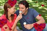 Composite image of woman feeding her friend ice cream