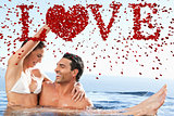 Composite image of happy couple enjoying time together in the pool