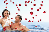 Composite image of couple enjoying time together in the pool