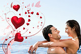 Composite image of couple embracing in the pool