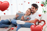 Composite image of in love couple using a tablet computer