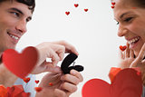 Composite image of close up of man making a proposal of marriage