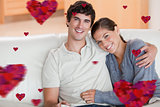 Composite image of happy couple enjoying their time together on the couch