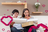 Composite image of couple on the couch opening parcel