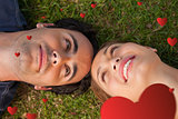 Composite image of close up of two friends looking at each other while lying head to head