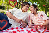 Composite image of two friends looking at each other while having a picnic
