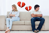 Composite image of a couple sit at the two ends of the couch with their arms folded looking away